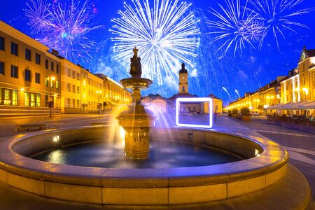 Fireworks display ovet the old town of Bialystok, Poland. Фото со стока - 134846456