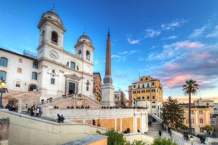 Trinita dei Monti church and the Spanish Steps in Rome at sunset, Italy