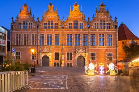 Architecture of the old town in Gdansk with emblem of the city made by lights, Poland Фото со стока - 134846660