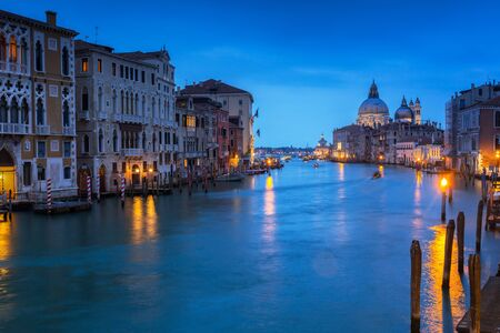 Venice city at dusk with Santa Maria della Salute Basilica, Italy