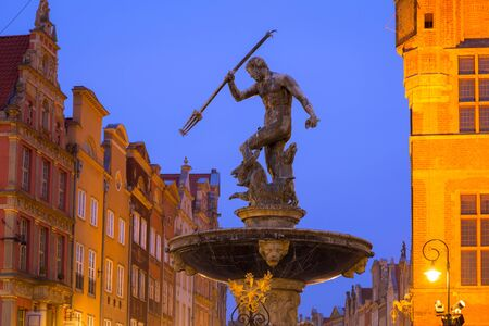 Beautiful architecture of the old town in Gdansk with Neptune fountain at dawn, Poland