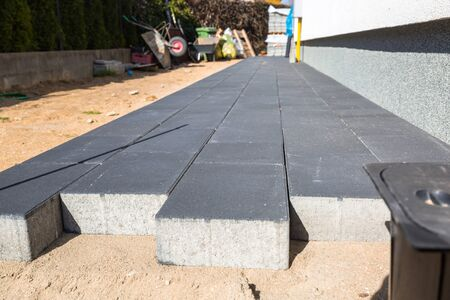 Concrete paver blocks laid near the house