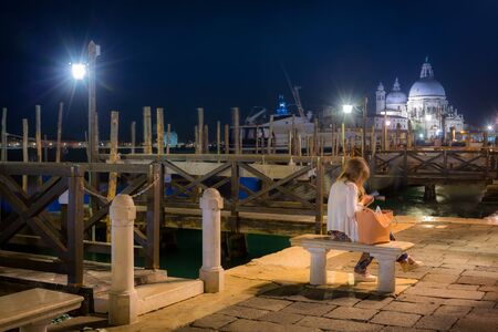 Venice city with Santa Maria della Salute Basilica at night, Italy