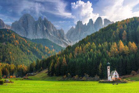 Scenery of Dolomites with the St. John's in Ranui Chapel (La Chiesetta di San Giovanni in Ranui), Santa Maddalena. Italy Stock Photo