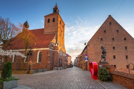 Old town with brick architecture at sunset, Grudziadz. Poland.