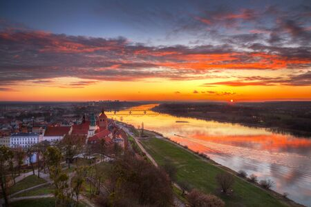 Old town of Grudziadz and the Vistula River at sunset. Kuyavian-Pomeranian Voivodeship, Poland.
