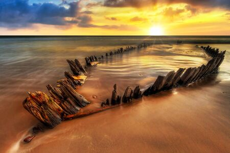 Ship wreck on the Rossbeigh beach in Co. Kerry at sunset, Ireland Stock Photo