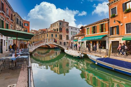 Venice, Italy - October 24, 2019: Canals of Venice city with boats and traditional colorful architecture, Italy Editorial