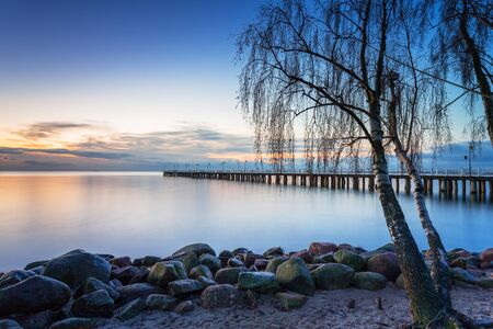 Beautiful landscape with wooden pier in Gdynia Orlowo at sunrise, Poland Foto de archivo