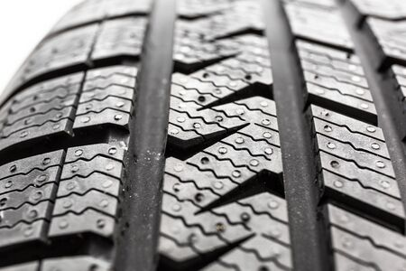 Car tire close up isolated on white background.