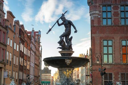 Fountain of Neptune in old town in Gdansk, symbol of the city. Poland Stock Photo