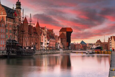 Gdansk with beautiful old town over Motlawa river at sunset, Poland. Stock Photo