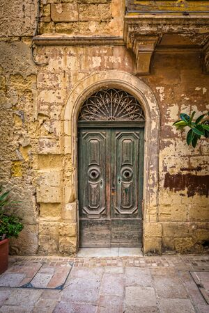 Narrow streets and architecture of the old town in Birgu, Malta