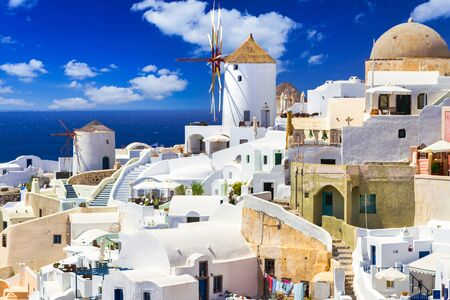 White architecture with the windmill of Oia town on Santorini island, Greece