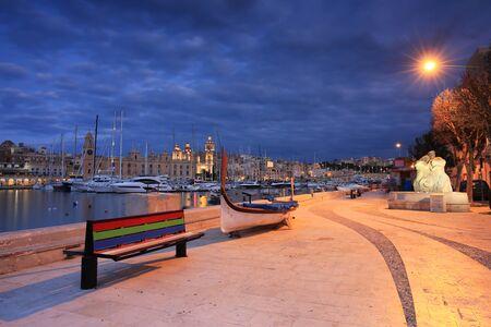 Beautiful architecture of the Birgu marina at sunset, Malta