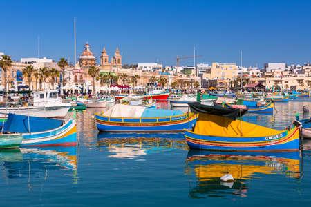 Sliema, Malta - January 10, 2020: Traditional fishing boats in the Mediterranean Village of Marsaxlokk, Malta