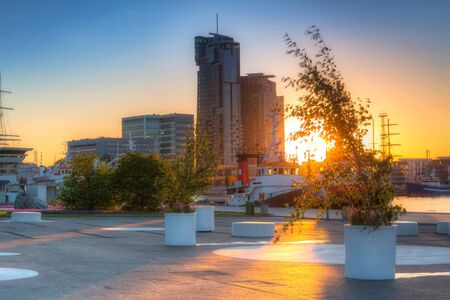 Square in Gdynia by the Baltic Sea at sunset. Poland