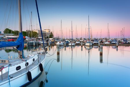 Beautiful sunset over the marina at Baltic Sea with yachts in Gdynia, Poland.