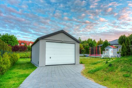 Free standing garage in the garden at sunset Archivio Fotografico