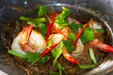 Thai dish with king prawns on the pan