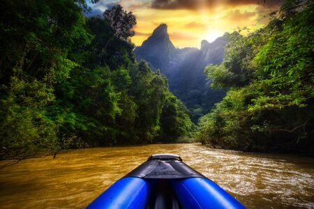 Rafting in the rainforest of Khao Sok National Park at sunset, Thailand