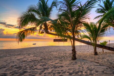 Beautiful sunset on the beach of Ko Kho Khao island with palm trees, Thailand