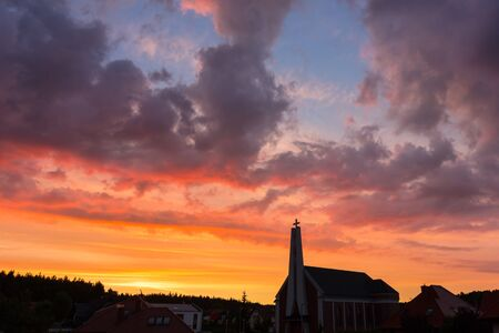 Beautiful sunset in the sky with the silhouette of a church