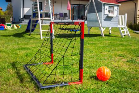 Garden playground for children with a mini soccer goal
