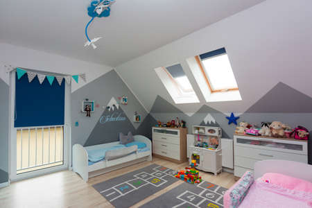 Children bedroom for a boy and a girl with furniture and toys