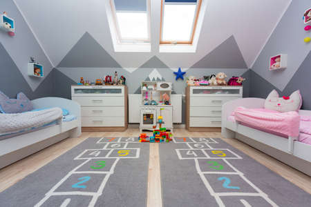 Children bedroom for a boy and a girl with painted mountains on the walls 免版税图像