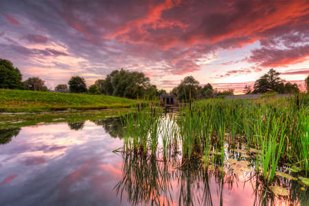Beautiful sunset over the pond in Pruszcz Gdanski, Poland.