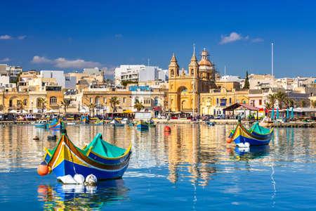 Traditional fishing boats in the Mediterranean Village of Marsaxlokk, Malta Banque d'images