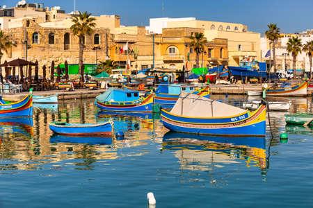 Marsaxlokk, Malta - January 10, 2020: Traditional fishing boats in the Mediterranean Village of Marsaxlokk, Malta Editorial