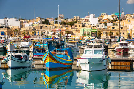 Marsaxlokk, Malta - January 10, 2020: Traditional fishing boats in the Mediterranean Village of Marsaxlokk, Malta