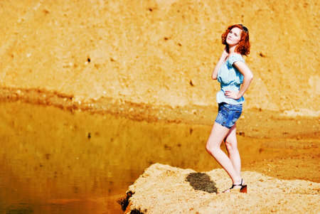 Beautiful young woman with red hair photo