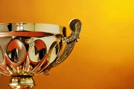 awards ceremony: Trophy cup on orange background