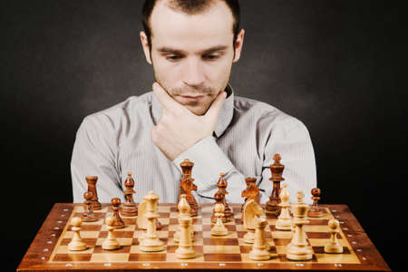 board game: Man at chess board Stock Photo