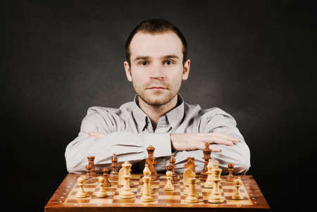 Man at chess board photo