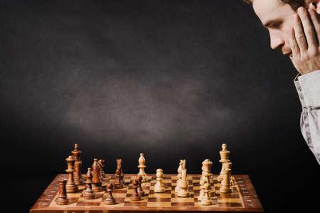 Man at chess board Stock Photo - 12661499
