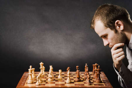 playing chess: Man at chess board Stock Photo
