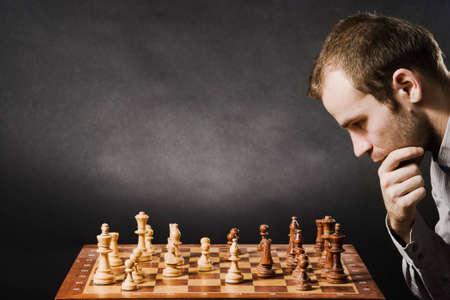 thinker: Man at chess board Stock Photo