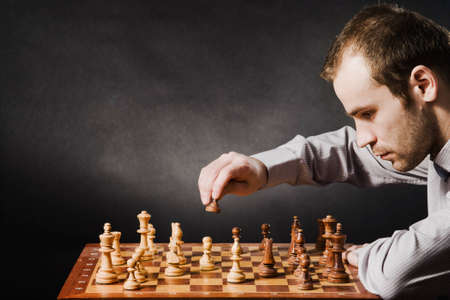 challenger: Man at chess board Stock Photo