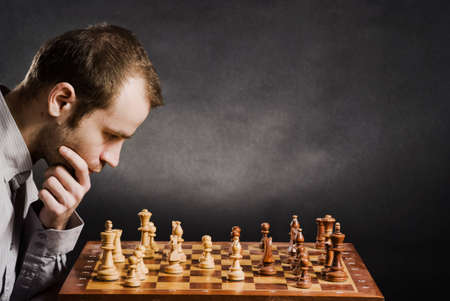 Man at chess board Stock Photo - 12661512