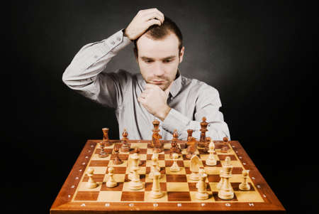Man at chess board photo