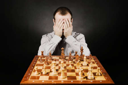 Man at chess board Stock Photo - 12661497