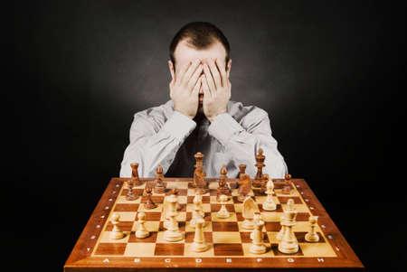 Man at chess board Stock Photo - 12661497