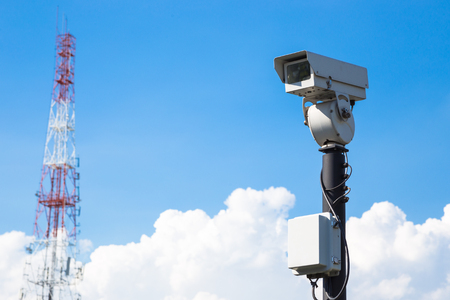 closed circuit: closed circuit camera and  tower Radio wave signals outdoor on blue sky background Stock Photo