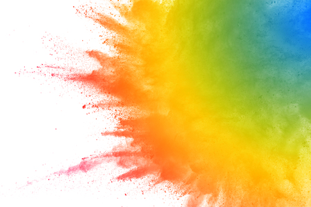 combustible: Multicolored powder explosion on white background. Stock Photo