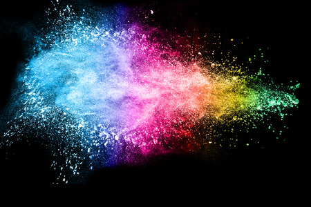abstract color powder explosion on  black background.abstract  Freeze motion of color powder splash. Фото со стока
