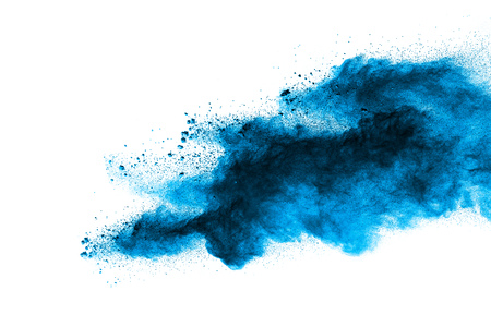 Abstract blue dust explosion on  white background. Abstract blue powder splattered on white background. Freeze motion of blue powder splash.